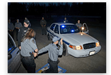 Cadets are shown the proper steps in conducting a high risk vehicle stop.