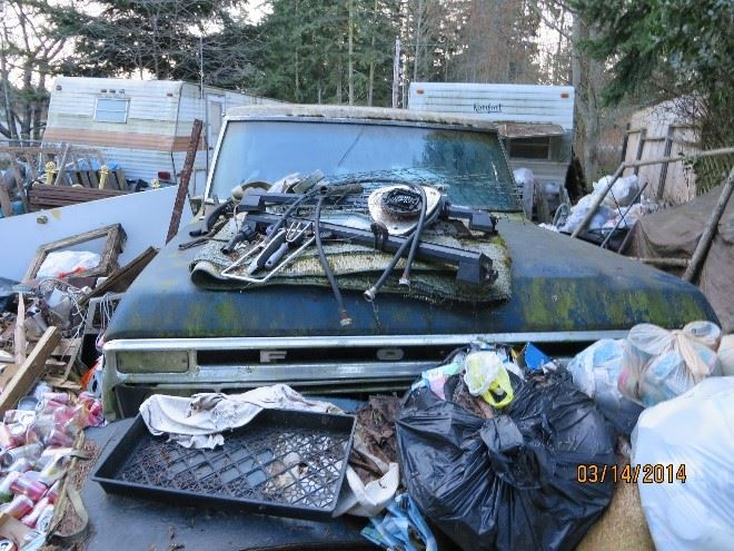 Trash, junk and old vehicle at Moore Street property before successful cleanup